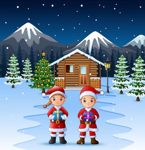 Paar weihnachtsmann, der ein kastengeschenk hält Premium Vektoren