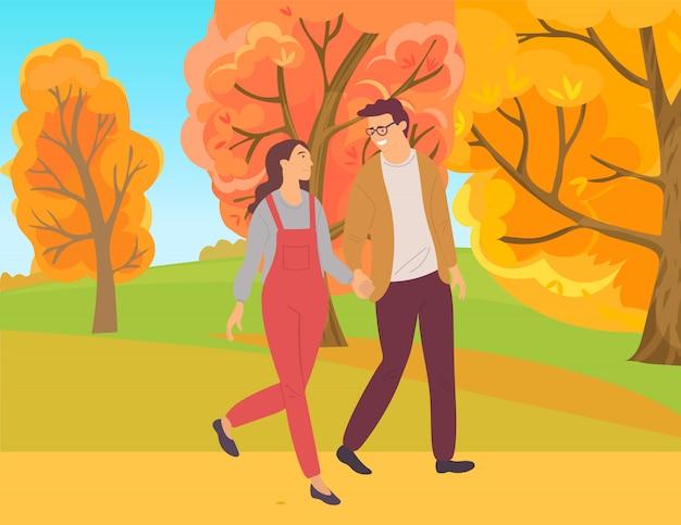 Paare, die in autumn forest, park-laub gehen Premium Vektoren