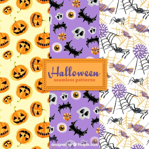 Pack halloween-muster mit aquarell-elementen Kostenlosen Vektoren