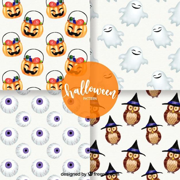 Pack halloween-muster mit schönen aquarell-elementen Kostenlosen Vektoren