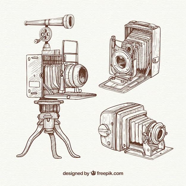 Packung handgezeichnete professionelle vintage kameras Kostenlosen Vektoren