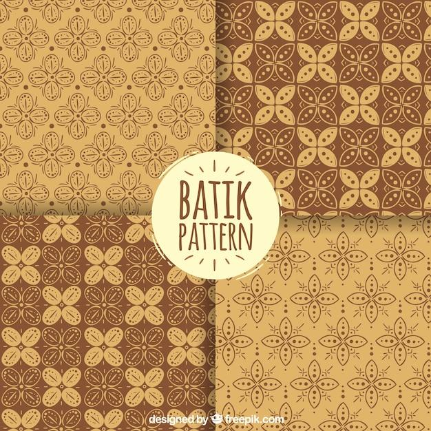 Packung mit batik dekorativen blumenmuster Kostenlosen Vektoren