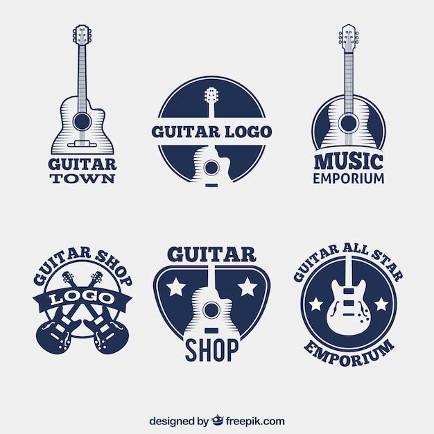Packung mit dunkelblauen logos mit gitarren Kostenlosen Vektoren
