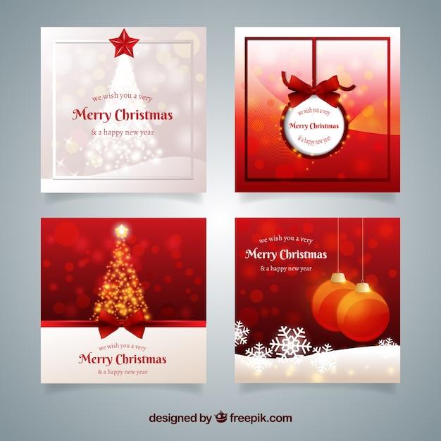 Packung mit eleganten rötlichen weihnachtskarten Kostenlosen Vektoren