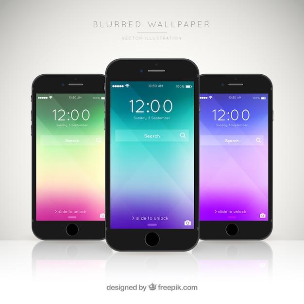 Packung von drei Handys mit eleganten farbigen Tapeten Kostenlose Vektoren