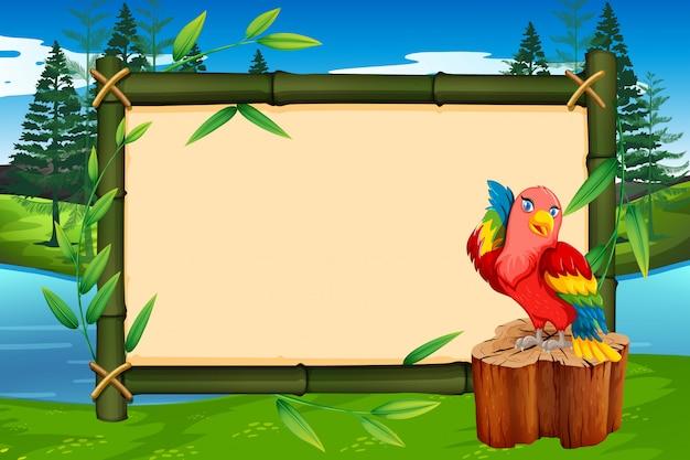 Papagei auf bambusrahmen mit copyspace Premium Vektoren