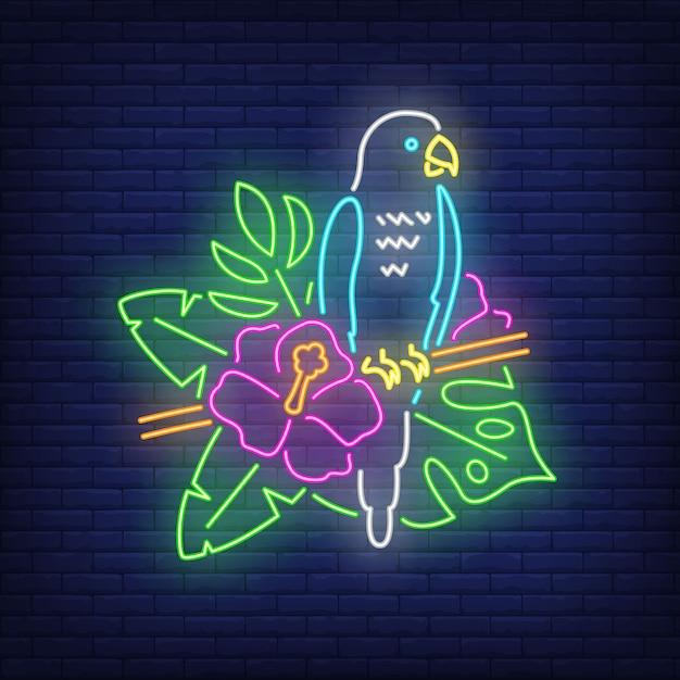 Papagei leuchtreklame. blauer tropischer vogel auf blühendem zweig. leuchtende banner- oder plakatelemente. Kostenlosen Vektoren