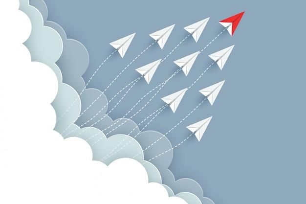 Papierflugzeug rot und weiß fliegen in den himmel. kreative idee. abbildung vektor cartoon Premium Vektoren