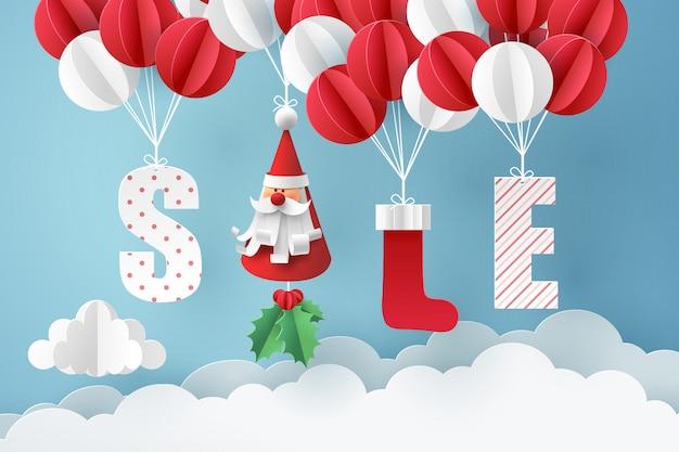 Papierkunst von santa claus und von rotem sockenmobile, die mit ballon auf himmel hängen Premium Vektoren