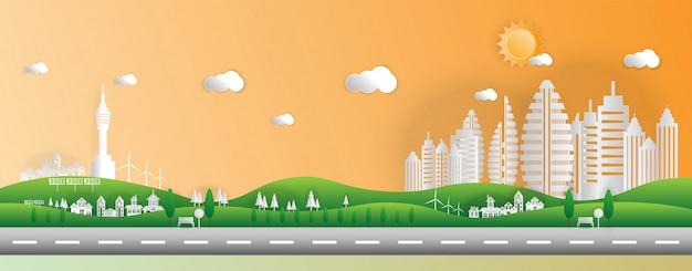 Papierkunstart der landschaft in der stadt mit sonnenuntergang. Premium Vektoren