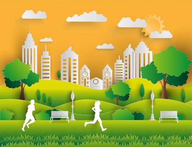Papierkunstart der landschaft in der stadt mit sonnenuntergang Premium Vektoren