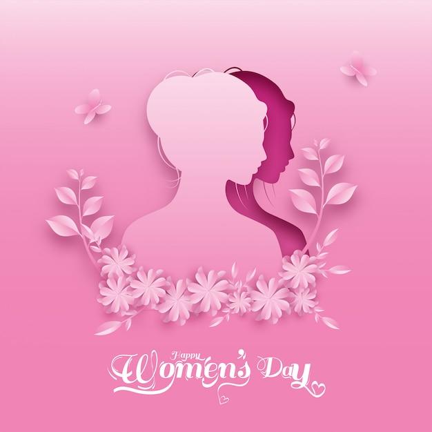 Papierschnitt-weibliches gesicht mit blumen, blättern und schmetterlingen auf rosa hintergrund für den tag der glücklichen frauen. Premium Vektoren