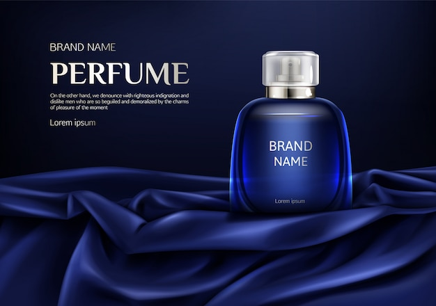 Parfümglasflasche auf blauer seide gefaltetem gewebe Kostenlosen Vektoren