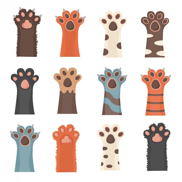 Pfoten hoch tiere isoliert auf weißem hintergrund. katzen- und hundepfoten, hintergrund, drucke, karikatur, niedliche tierbeine tapete. broschüre, flyer, postkarte. in flachem design. Premium Vektoren