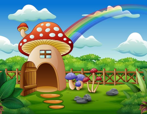 Pilzhaus mit einem regenbogen auf dem gebiet Premium Vektoren