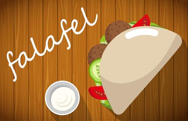 Platte von falafel mit pittabrot auf holztisch. Premium Vektoren