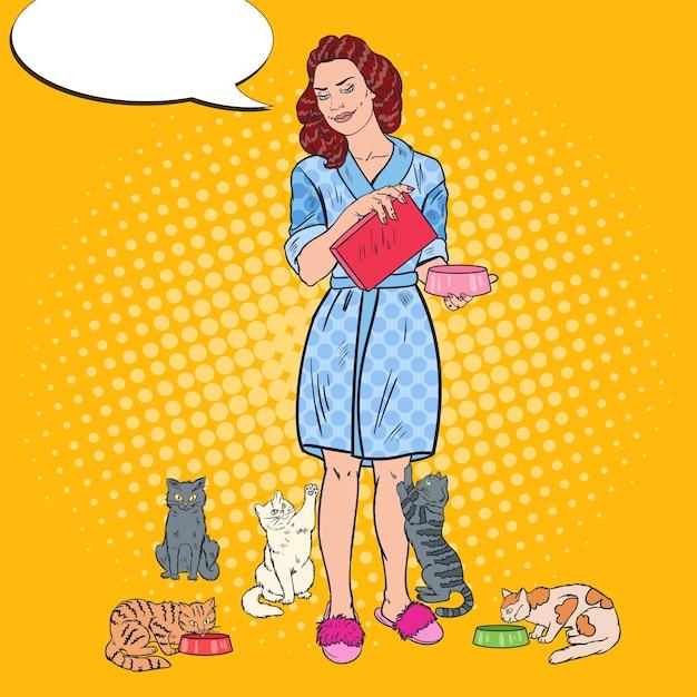 Pop-art-frau, die ihre katzen füttert Premium Vektoren