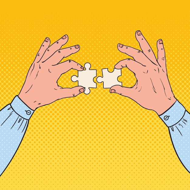 Pop art männliche hände, die zwei puzzleteile halten. geschäftslösungskonzept. Premium Vektoren