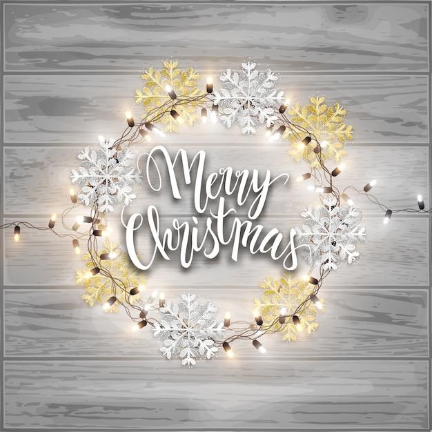 Postkarte der frohen weihnachten, funkelnschneeflocken und glänzende girlande der geführten lichter Premium Vektoren
