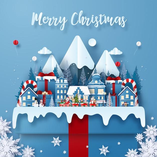 Postkarte weihnachtszug in der stadt auf einer großen geschenkbox mit santa claus Premium Vektoren