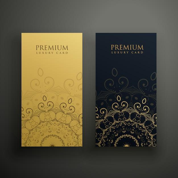 Premium-Mandala-Karten in Gold und schwarzen Farben Kostenlose Vektoren