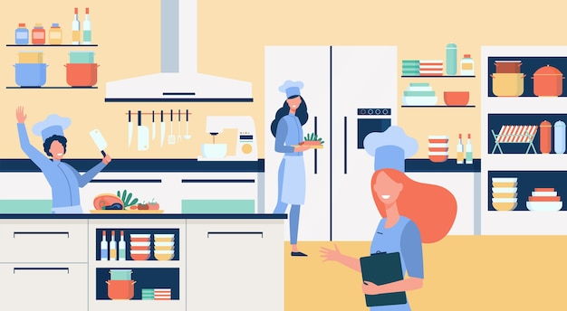 Professionelle köche, die an der flachen illustration der restaurantküche kochen. Kostenlosen Vektoren
