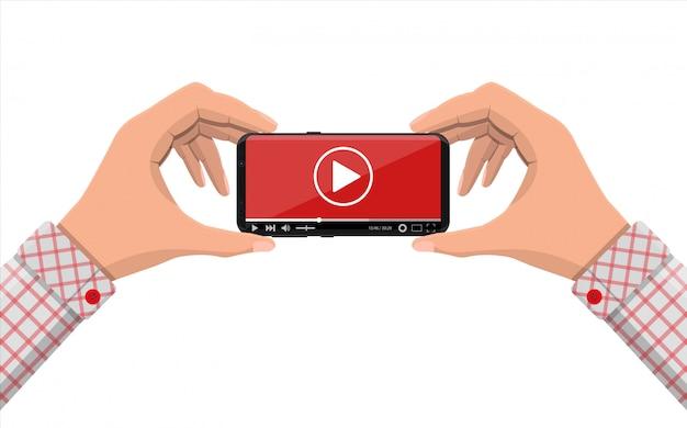 Rahmenloses smartphone mit videoplayer auf dem bildschirm. Premium Vektoren