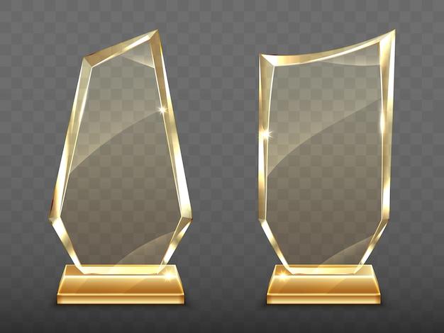 Realistische glas-trophäen-auszeichnungen auf goldbasis Kostenlosen Vektoren