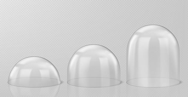 Realistische glaskuppeln, weihnachtsschneekugel-andenken isoliert Kostenlosen Vektoren