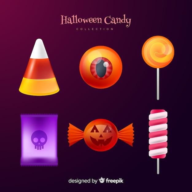 Realistische halloween-süßigkeitssammlung auf steigungshintergrund Kostenlosen Vektoren