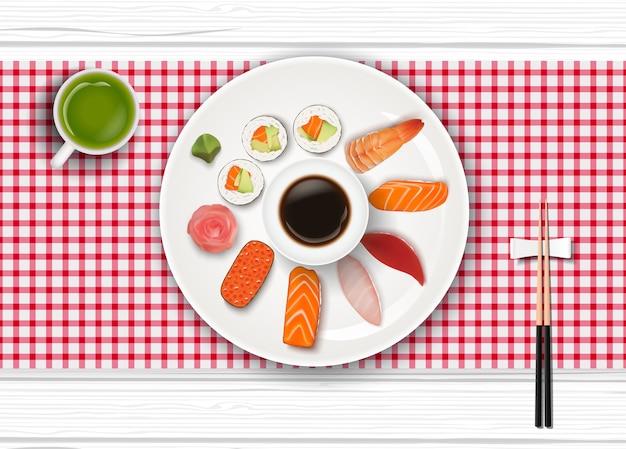 Realistische japanische sushi und grüner tee Premium Vektoren