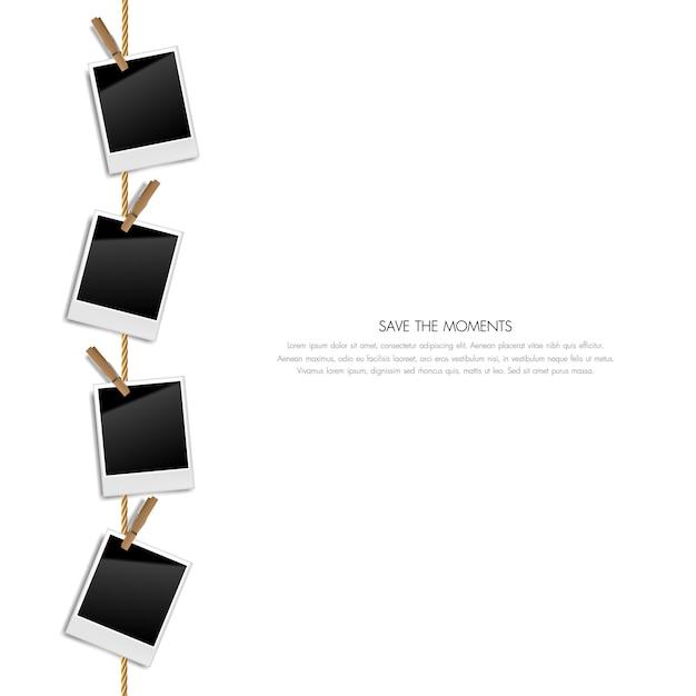 Realistische leere retro- fotorahmen auf einem seil mit holzklammern, vektorillustration Premium Vektoren