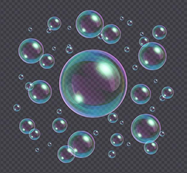 Realistische seifenblasen mit der regenbogenreflexion lokalisiert auf transparentem Premium Vektoren