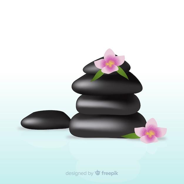 Realistische spa steine mit blumen Kostenlosen Vektoren