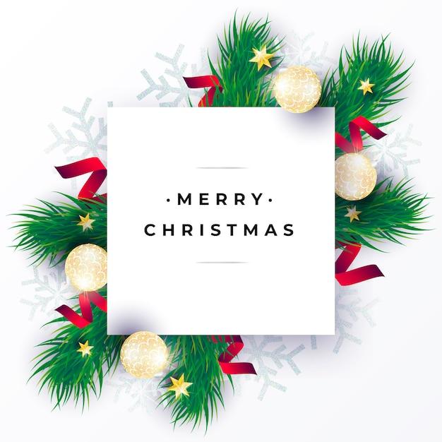 Realistische weihnachtskarte mit grünen zweigen Kostenlosen Vektoren