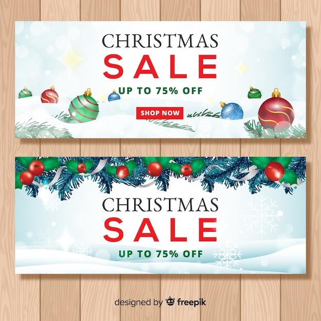 Realistische weihnachtsverkauf banner Kostenlosen Vektoren