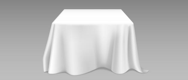 Realistische weiße tischdecke auf quadratischem tisch Kostenlosen Vektoren