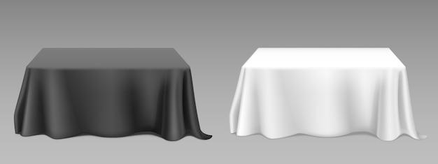 Realistische weiße tischdecke auf tischen Kostenlosen Vektoren