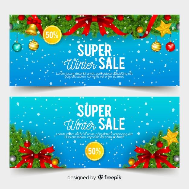 Realistische winterschlussverkauf-banner Kostenlosen Vektoren