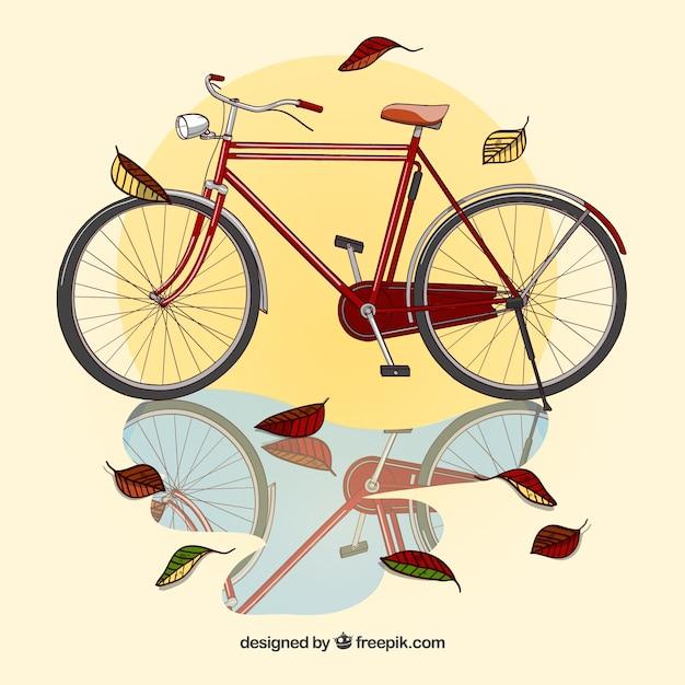 Realistischer herbsthintergrund mit fahrrad Kostenlosen Vektoren