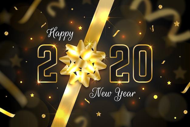Realistischer hintergrund 2020 des neuen jahres mit goldenem geschenkbogen Kostenlosen Vektoren