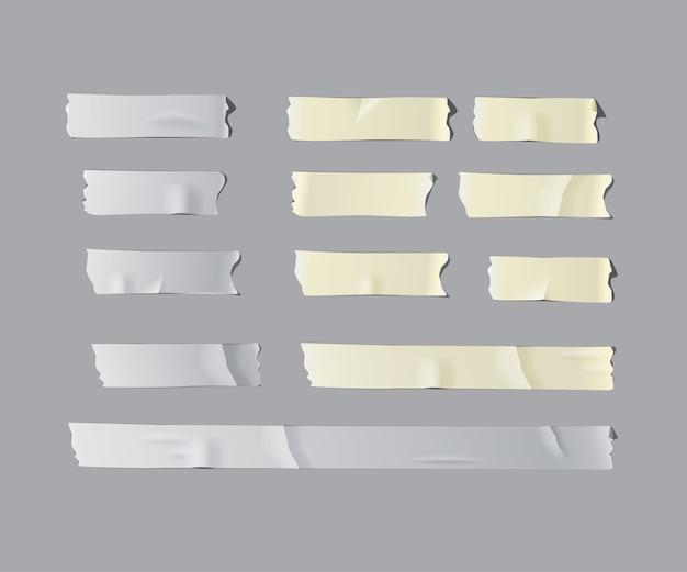 Realistischer isolierter klebebandsatz isoliert auf grauem hintergrund. Premium Vektoren