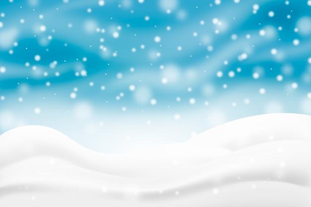 Realistischer schneefallhintergrund mit hügeln Kostenlosen Vektoren