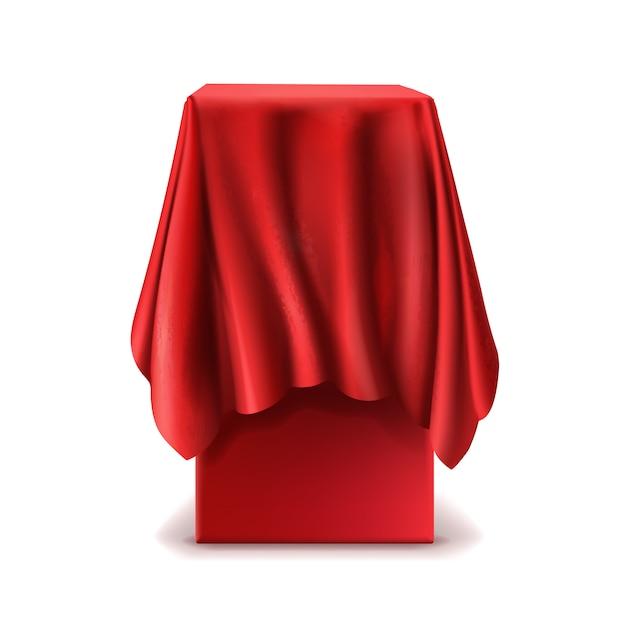 Realistischer stand bedeckt mit dem roten silk tuch lokalisiert auf weißem hintergrund. Kostenlosen Vektoren