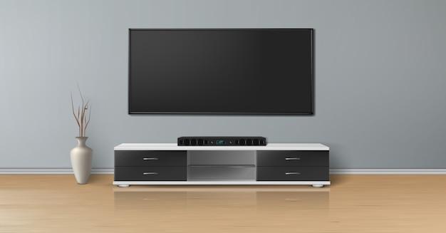 Realistisches modell eines leeren raumes mit plasmafernseher auf ebener grauer wand, heimkinosystem Kostenlosen Vektoren