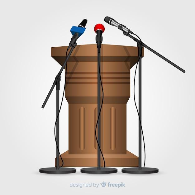 Realistisches podium mit mikrofonen für die konferenz Kostenlosen Vektoren