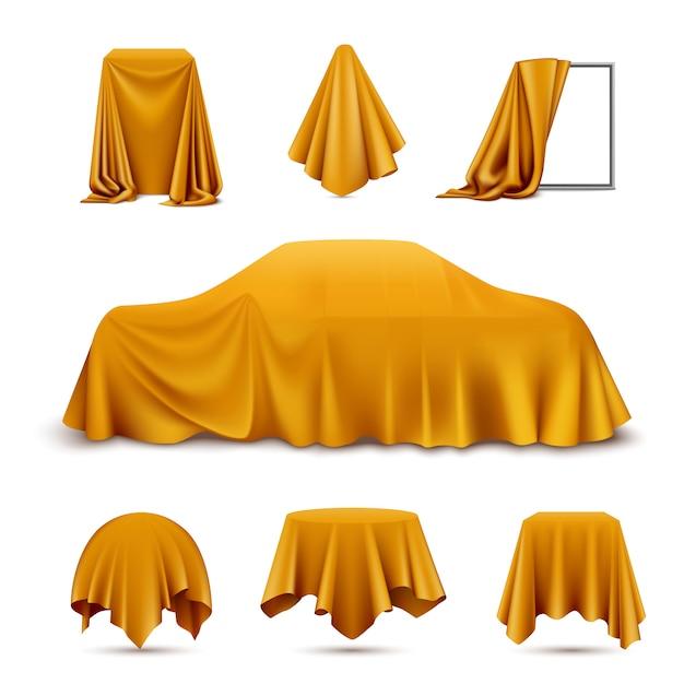 Realistisches set des mit goldenem seidentuch bedeckten objekts mit hängendem servietten-tischdeckenvorhang des drapierten rahmenautos Kostenlosen Vektoren