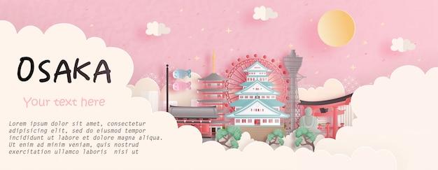 Reisekonzept mit berühmtem markstein osakas, japan im rosa hintergrund. papierschnitt illustration Premium Vektoren
