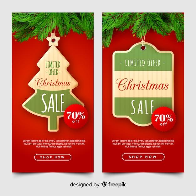 Reizende weihnachtsverkaufsfahnen mit realistischem design Kostenlosen Vektoren