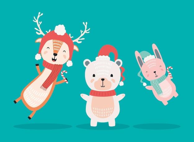 Rentier mit eisbär und kaninchen, die weihnachtskleidungsfiguren tragen Premium Vektoren